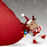 Christmas Deer pulling huge bag of gifts royalty free illustration