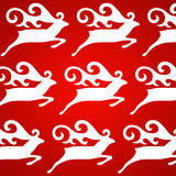 Christmas deer red background Stock Images