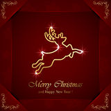 Christmas deer on red background Royalty Free Stock Photo