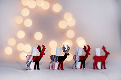 Christmas deer in a row on a bokeh background Royalty Free Stock Image