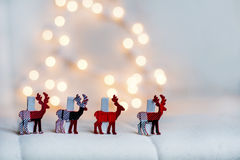 Christmas deer in a row on a bokeh background Stock Photo
