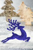 Christmas deer running in  snowing forest Stock Photos