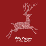 Christmas deer silhouette on red background Stock Images
