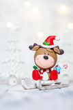 Christmas deer on a sleigh for decoration Stock Images