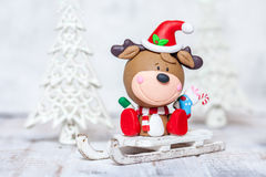 Christmas deer on a sleigh for decoration Royalty Free Stock Image