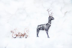 Christmas deer and sleigh made of copper wire. And beads. Handmade Christmas decorations Royalty Free Stock Images