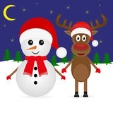 Christmas deer and snowman Royalty Free Stock Image