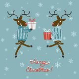 Christmas deer in sweater with gifts Stock Photo