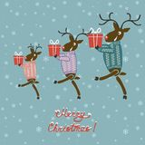 Christmas deer in sweater with gifts Royalty Free Stock Photography