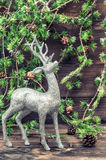 Christmas deer. Vintage style decoration with christmas tree bra Royalty Free Stock Image