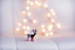 Christmas deer  on a white bokeh background Stock Photos