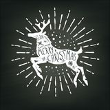 Christmas deer white silhouette on chalk board background Stock Photo