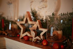 Christmas dekor. Wood stars for Christmas decoration on the nantique fireplace royalty free stock images