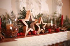 Christmas dekor. Wood stars for Christmas decoration on the nantique fireplace royalty free stock photography