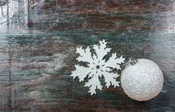 Christmas dekoration white tree toy and snowflake on a dark wooden background . Stock Photo