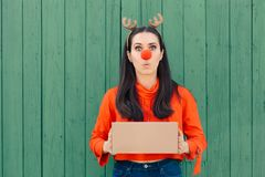 Christmas Delivery Girl Holding Many Packages. Woman holding cardboard gift boxes ready for Xmas royalty free stock image