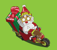 Christmas delivery. Santa Claus on a motorcycle Royalty Free Stock Image