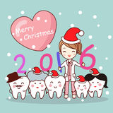 Christmas dentist with tooth family Stock Photo