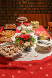 Christmas desert table with red cloth. Royalty Free Stock Photos