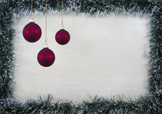 Christmas design-Christmas card fringed with pine needles and red balloons with place for text. Studio photography royalty free stock photos