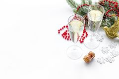 Christmas design with decoration, spruce branch, champagne in glasses on white background copyspace Royalty Free Stock Images