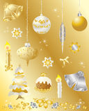 Christmas design elements set in gold and silver. An illustration of christmas design elements set in gold and silver on a gold background Royalty Free Stock Photo