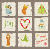 Christmas Design Elements on torn Paper - Stock Photos