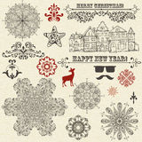 Christmas Design Elements. Vintage holiday design elements and snowflakes, houses Stock Illustration