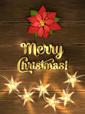 Christmas design - Merry Christmas. Xmas greeting with red poinsettia, golden lettering and christmas star-lights. Royalty Free Stock Photography