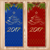 Christmas design set. Merry Christmas and Happy New Year 2017. Set  greeting cards with ribbons, bows and fir branches on a wooden background Royalty Free Stock Image
