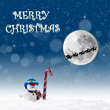 Christmas design snowman under blue full moon Stock Images