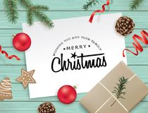 Christmas design template. Christmas flat lay design with gift, cookies, ribbons, Christmas balls, pine cones, fir branches and greeting card on wooden Royalty Free Stock Photos