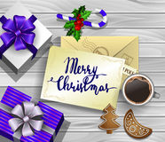 Christmas design on wood. Christmas New Year design wooden background with christmas decorations candy canes with gift boxes and envelope handwritten Merry Royalty Free Stock Photos
