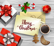 Christmas design on wood. Christmas New Year design wooden background with christmas decorations candy canes with gift boxes and envelope handwritten Merry Stock Photography