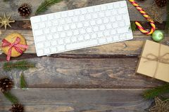 Christmas desktop with keyboard and Christmas decor. Horizontal stock photos