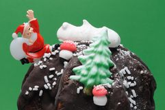 Christmas Dessert. Decorated christmas chocolate dessert, over green background Stock Images