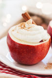 Christmas dessert in apple with whipped cream, cinnamon and wild berries Royalty Free Stock Photos
