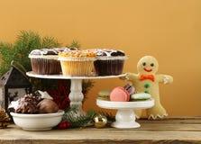 Christmas dessert buffet muffins, cookies, macaroon Stock Photos