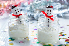 Christmas dessert, cheesecake cream with  marshmallow snowman Stock Image