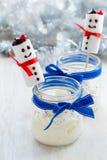 Christmas dessert, cheesecake cream with  marshmallow snowman Stock Photos