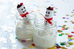 Christmas dessert, cheesecake cream with  marshmallow snowman Royalty Free Stock Photos