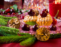 Christmas dessert - cupcakes with red cherries Stock Photography