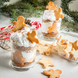 Christmas dessert, funny Ginger Trifle. Christmas dessert, funny food for children or party. Ginger Trifle with gingerbread in form of men, diving in the drifts stock photo