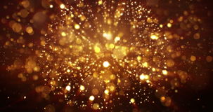Christmas digital glitter sparks golden particles bokeh explosion on black background, holiday xmas festive stock footage