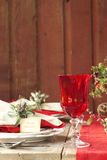 Christmas dining scene on rustic wood table and wall Stock Image