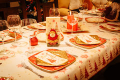 Christmas Dining Table with Christmas Tree in Background Royalty Free Stock Images