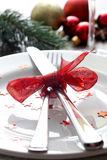 Christmas dinner. Christmas place setting with ribbon Royalty Free Stock Photo