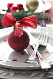 Christmas dinner. Christmas place setting with red christmas ball Stock Photography