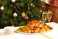 Christmas Dinner. A platter containing a christmas dinner with a christmas tree in the background Royalty Free Stock Photo