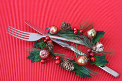 Christmas Dinner. Knife and Fork in a christmas decoration as a table setting Royalty Free Stock Images